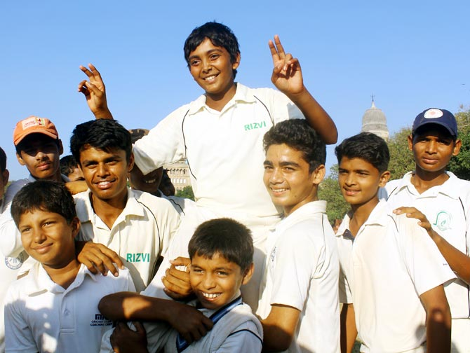 Prithvi Shaw celebrates with Rizvi Springfield team mates after the end of day's play