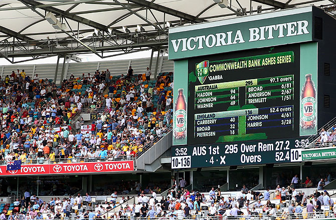A general view of the scoreboard after Australia bowled England out for 136 in their first innings during day two of the First Ashes Test at The Gabba in Brisbane on Friday