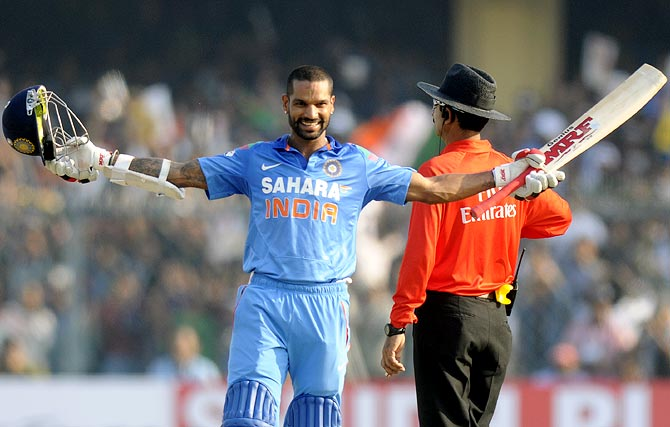Shikhar Dhawan celebrates after completing his century