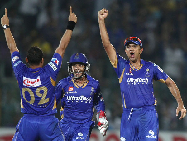 Pravin Tambe of Rajasthan Royals celebrates as teammates Dishant Yagnik and Rahul Dravid congratulate him