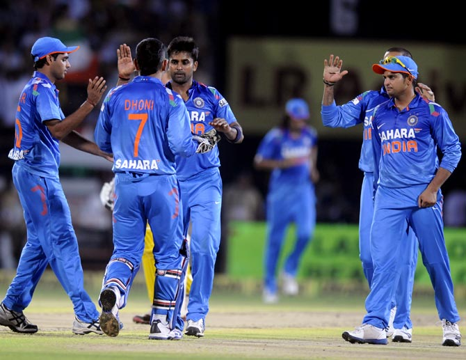 The Indian team celebrate after R Vinay Kumar (centre) took the wicket of Shane Watson
