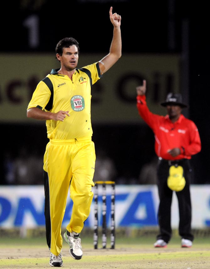 Clint McKay celebrates the wicket of Rohit Sharma