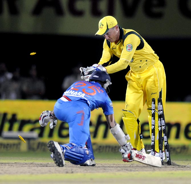 Shikhar Dhawan is stumped off Brad Haddin