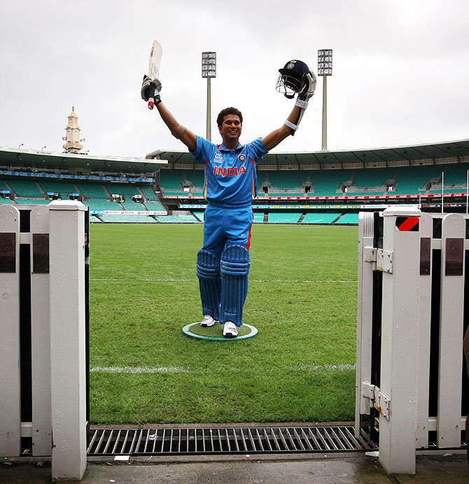 A wax figure of Indian cricketer Sachin Tendulkar stands on the Sydney Cricket Ground during a promotional event for Madame Tussauds wax museum in April 2013
