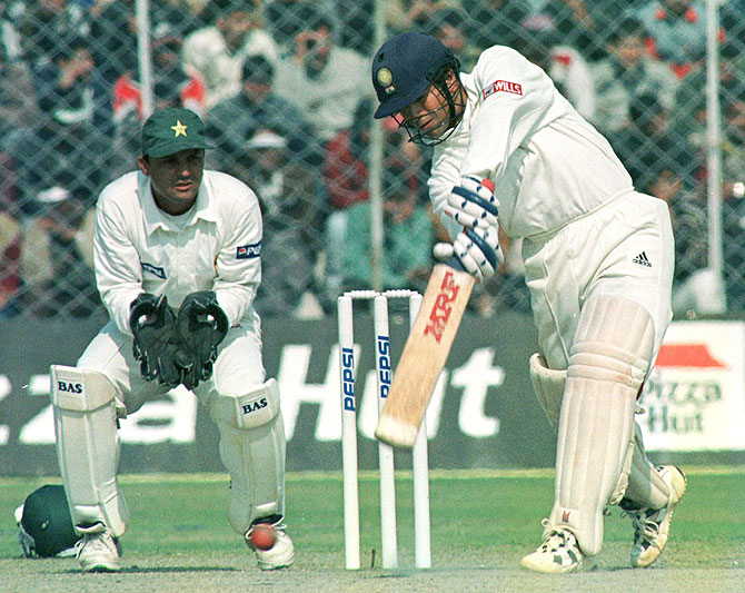 Sachin Tendulkar bats as Moin Khan watches in 1999