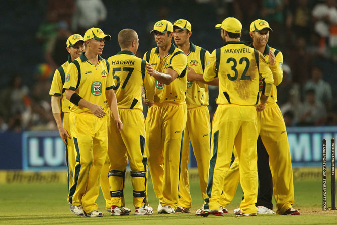 Australian team celebrates fall fo an Indian wicket
