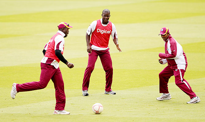 West Indies captain Darren Sammy (centre) with teammates during a nets session