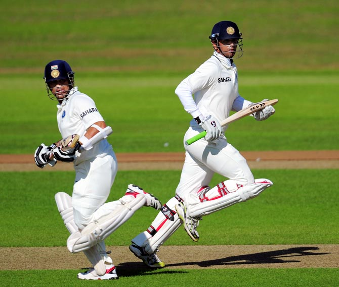 Rahul Dravid (right) with Sachin Tendulkar run between the wickets