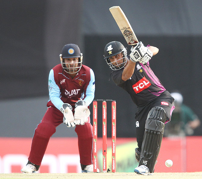 Muhammad Salman of the Faisalabad Wolves drives a delivery during the match against Kandurata Maroons on Friday