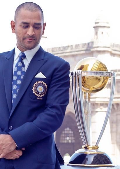 India's cricket team captain Mahendra Singh Dhoni poses with the ICC Cricket World Cup Trophy
