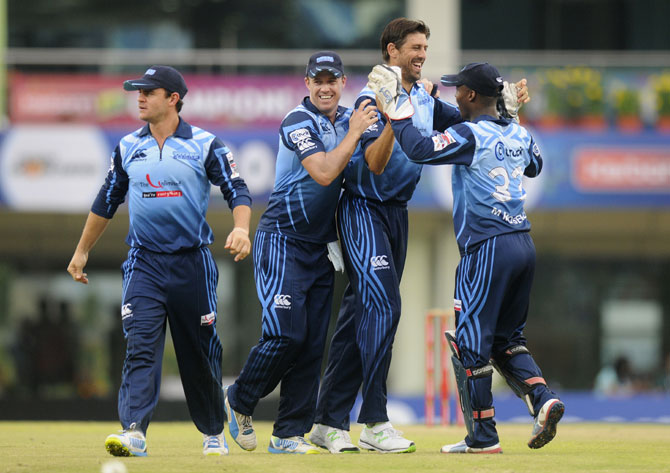 David Wiese of Titans celebrates a wicket with teammates