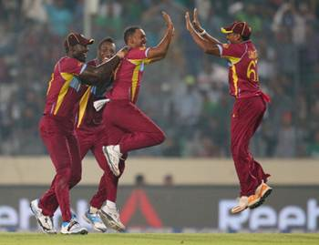 Samuel Badree of the West Indies is congratulated by Darren Sammy and his teammates after dismissing Shoaib Malik of Pakistan
