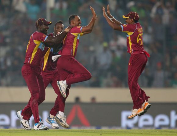 Samuel Badree celebrates after picking a wicket
