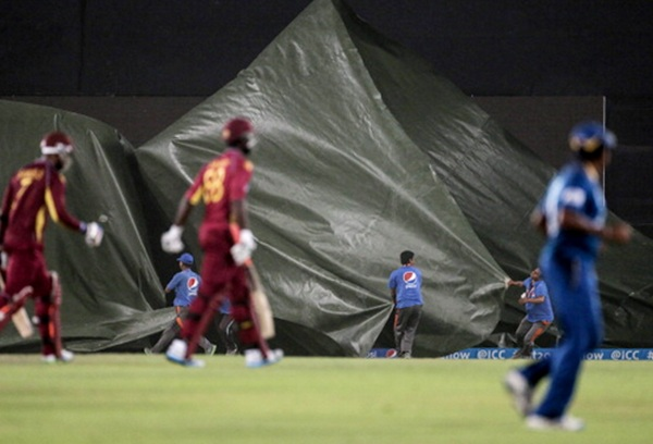 Groundstaff pull the covers on as a hailstorm approaches during the first sem-final between Sri Lanka and West Indies at the Sher-e-Bangla in Mirpur, Bangladesh