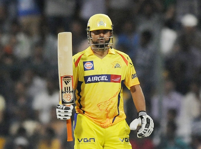 Suresh Raina acknowledges the cheers from the crowd after getting to fifty
