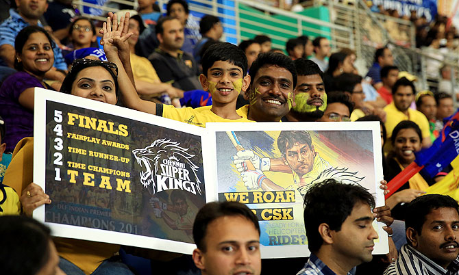 A fan holds up an interesting poster during the IPL match between Chennai Super Kings and Delhi Daredevils on Monday