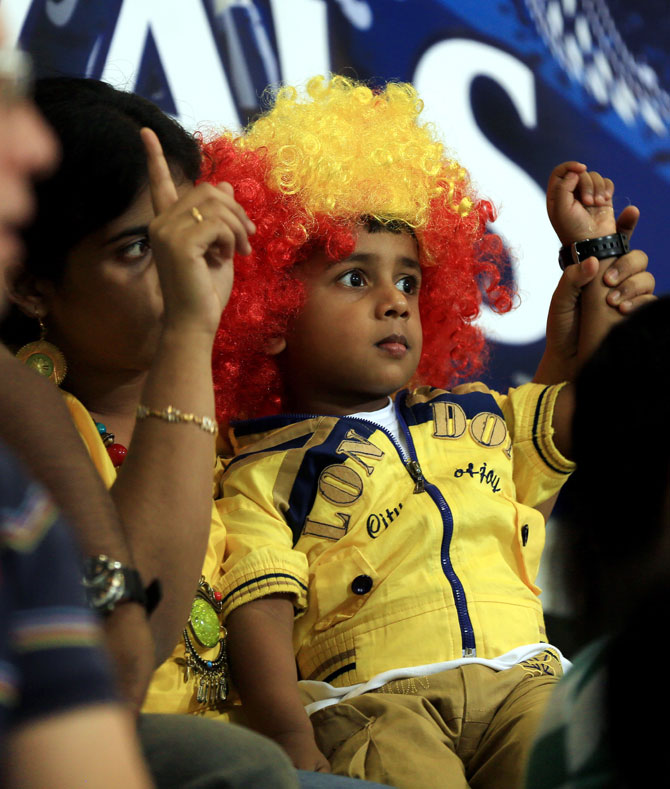 A kid and his mother enjoy the cricketing action on Monday
