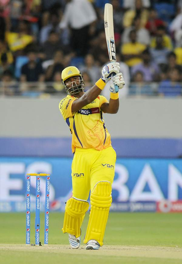 Chennai Super Kings' Dwayne Smith steps out to hit James Falkner for a six.