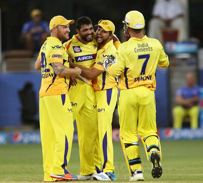 Jadeja (2nd right) celebrates with team mates after taking the wicket of Sanju Samson