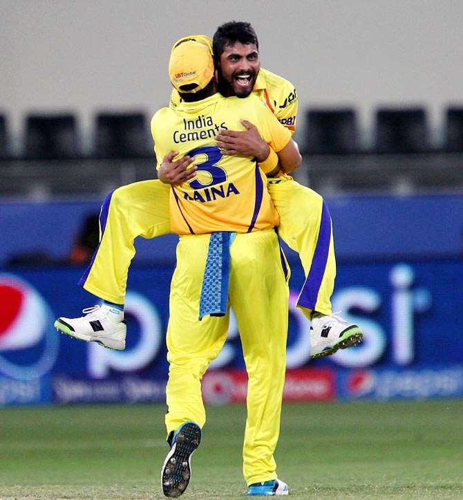 Ravindra Jadeja celebrates with Suresh Raina after taking the wicket of Steven Smith