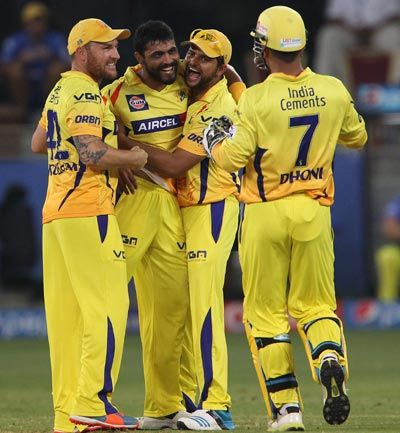 Ravindra Jadeja (centre) is congratulated by Brendon McCullum (left), Suresh Raina (right) and Chennai skipper Mahendra Singh Dhoni.