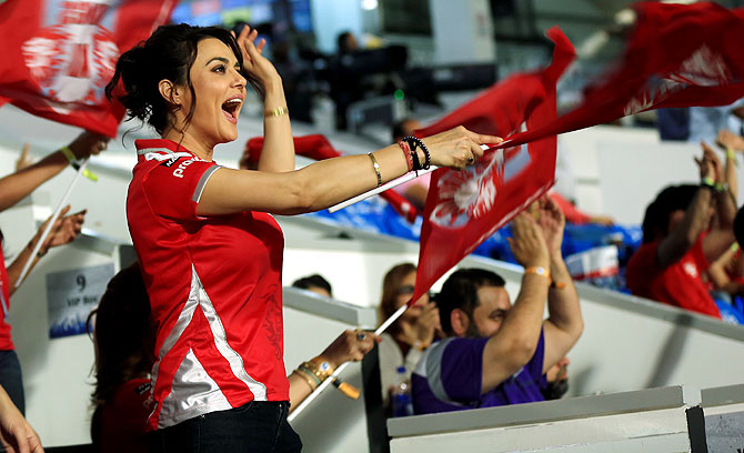 Preity Zinta waves the Kings XI Punjab team flag on Tuesday
