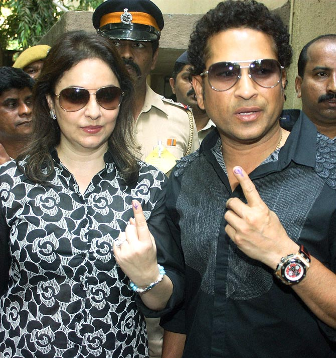 Sachin Tendulkar and his wife Anjali after casting their votes in Mumbai on Thursday.