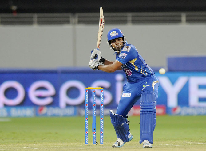 Mumbai Indians captain Rohit Sharma hits a shot