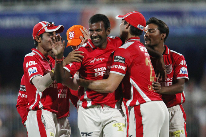 Lakshmipathy Balaji celebrates with his Kings XI Punjab teammates