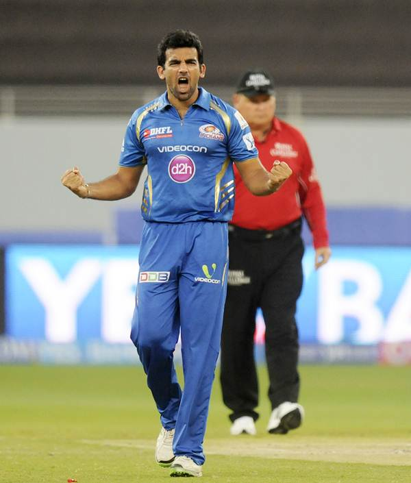 Mumbai Indians' Zaheer Khan celebrates after dismissing Sunrisers Hyderabad's Shikhar Dhawan
