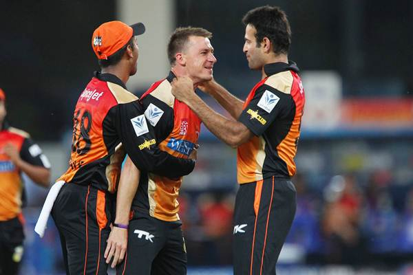 Dale Steyn is congratulated by Irfan Pathan after dismissing Corey Anderson