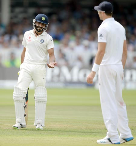 Ravindra Jadeja of India speaks with James Anderson of England during day four of second Test at Lord's Cricket Ground on July 20, 2014