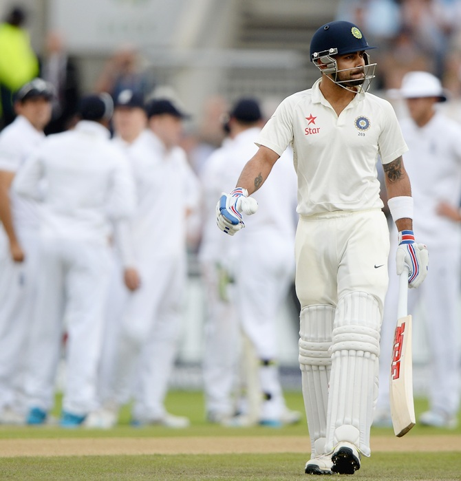 Virat Kohli of India leaves the field after being dismissed by James Anderson