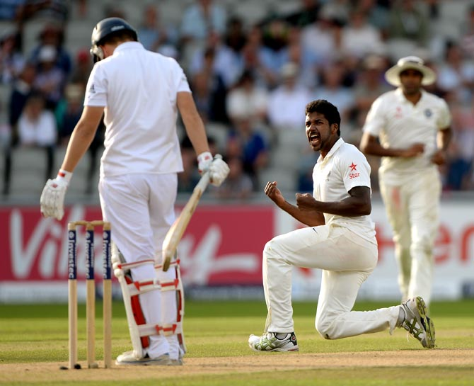 Varun Aaron (right) of India celebrates dismissing Gary Ballance