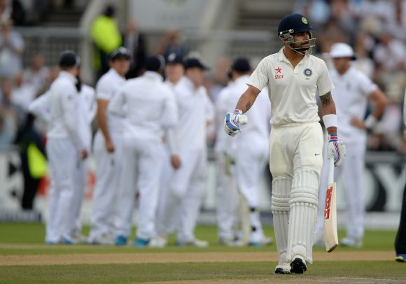 Virat Kohli walks back after being dismissed