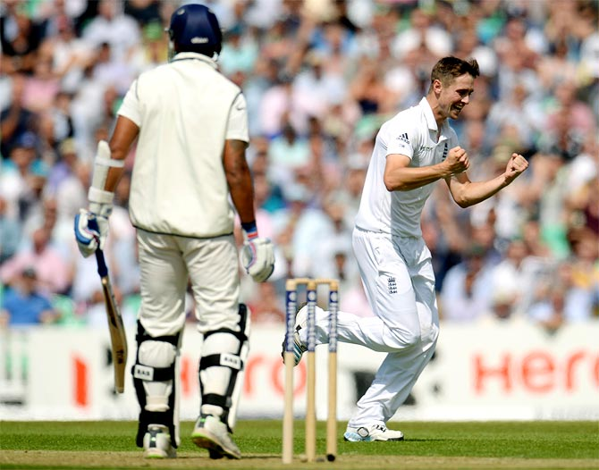 England's Chris Woakes (right) celebrates after dismissing India's Murali Vijay