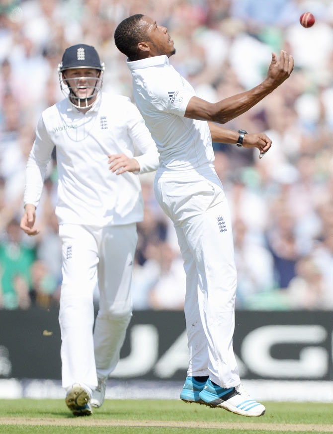Chris Jordan of England celebrates catching out Ajinkya Rahane