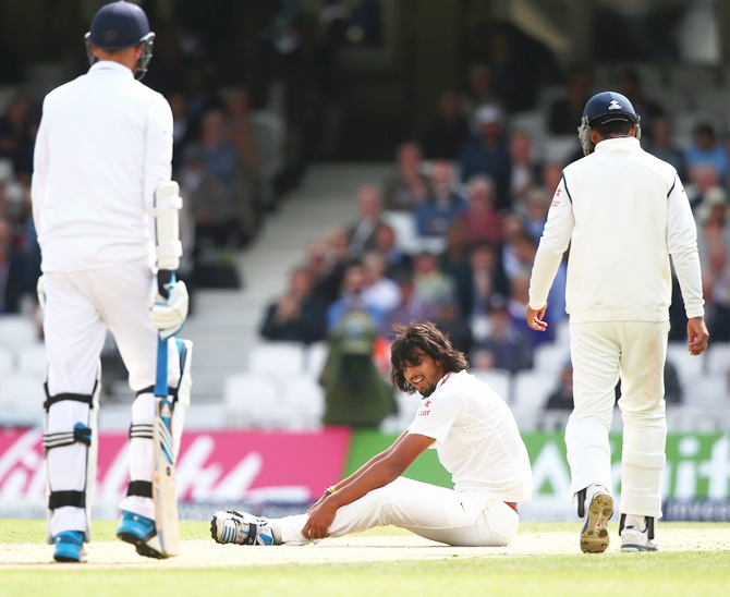 Ishant Sharma of India looks on after taking the wicket of Stuart Broad of England