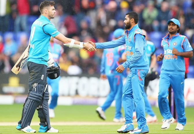 James Anderson, left, of England shakes hands with Ravindra Jadeja of India after India's 133 run victory