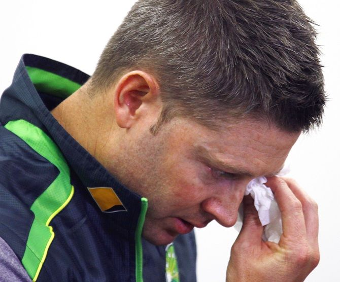 Australian cricket captain Michael Clarke wipes his eyes