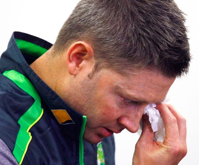 Australian cricket captain Michael Clarke wipes his eyes as he breaks down during a press conference
