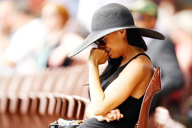 A woman reacts during the funeral service for Phillip Hughes