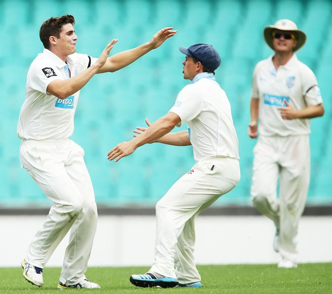 Sean Abbott, left, of the Blues celebrates with Stephen O'Keefe