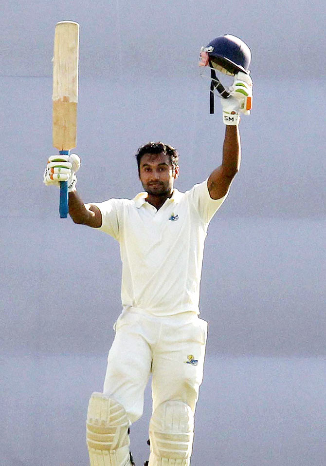 Himachal Pradesh batsman Paras Dogra celebrates his double century during the 2nd day of the Ranji Trophy match against Assam, in Guwahati on Monday