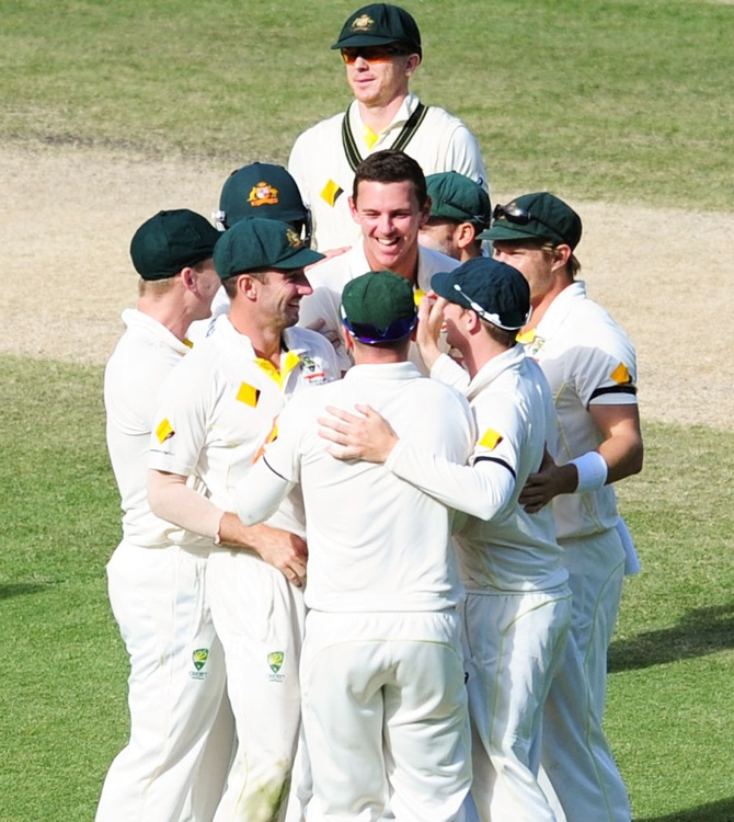 Josh Hazelwood celebrates a wicket with teammates on the final day of the Melbourne Test, December 30, 2014. Photograph: Vince Caligiuri/Getty Images