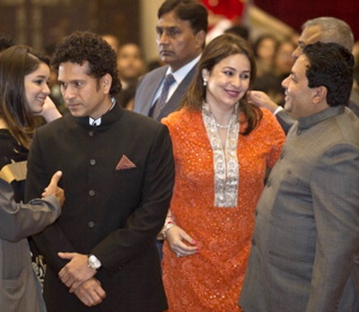 Sachin Tendulkar with his wife Anjali (right) and daughter Sara (background) during the investiture ceremony on Tuesday