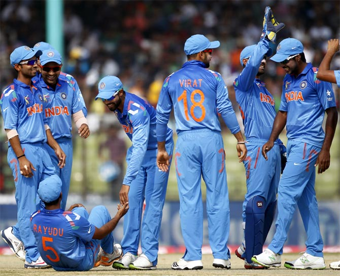 India's fielders celebrate the dismissal of Bangladesh's Shamsur Rahman (unseen)