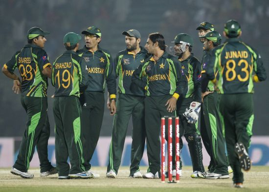 Pakistan players celebrate the fall of a wicket