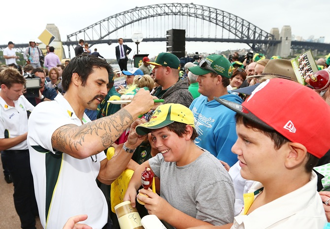 Mitchell Johnson sign autographs for fans