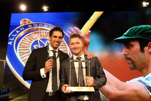 Mitchell Johnson poses with Michael Clarke after winning the Allan Border Medal during the 2014 Allan Border Medal at Doltone House in Sydney on Monday